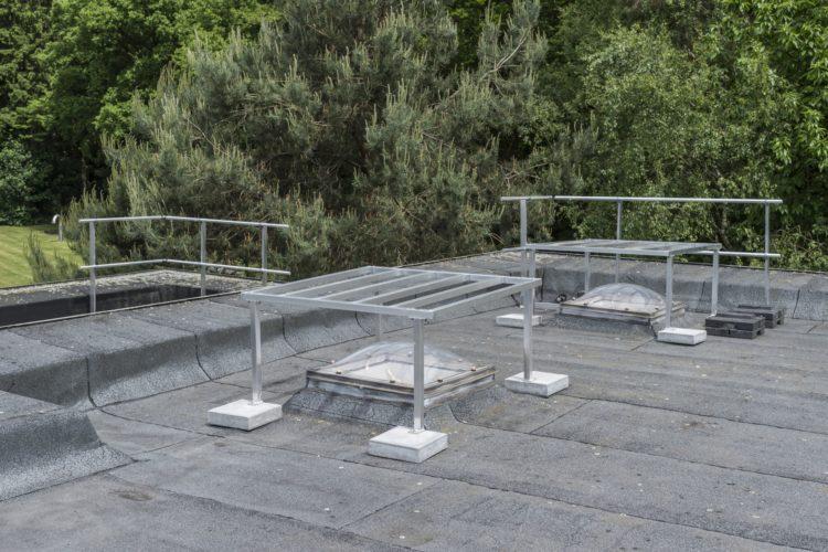 hekwerk op plat dak